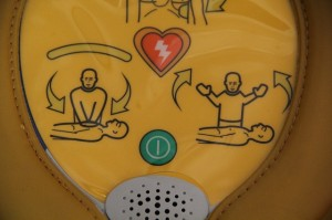 close up of on/off button on Heartsine public access defibrillator